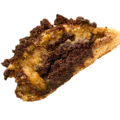 """""""Brownie Bomb"""" Our original cookie dough base, stuffed with a decadent chocolate brownie, drizzled with a thick chocolate, topped with extra brownie chunks"""