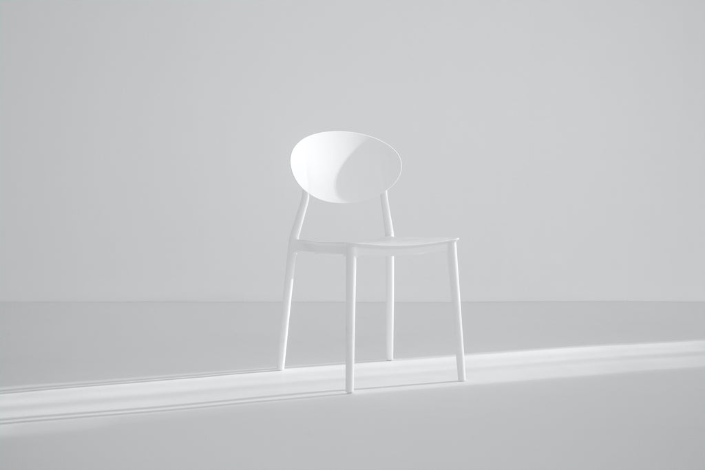 White chair in empty room