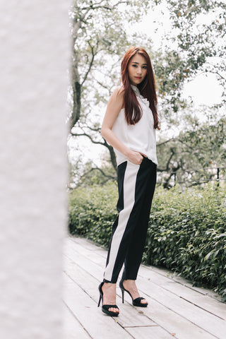 Alicia Tan in the Eloise Organza Panel Sleeveless Top in White & Charlize Contrast Panel Tapered Pants in Black with White Stripe