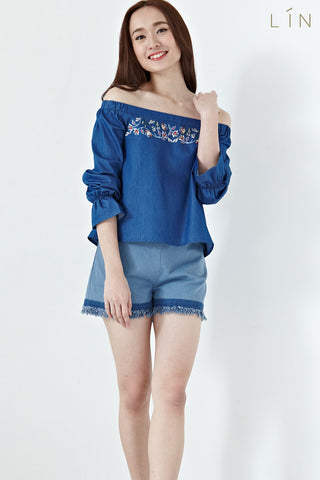 Jacquelina Off Shoulder Long Sleeves Top with Floral Embroidery in Denim