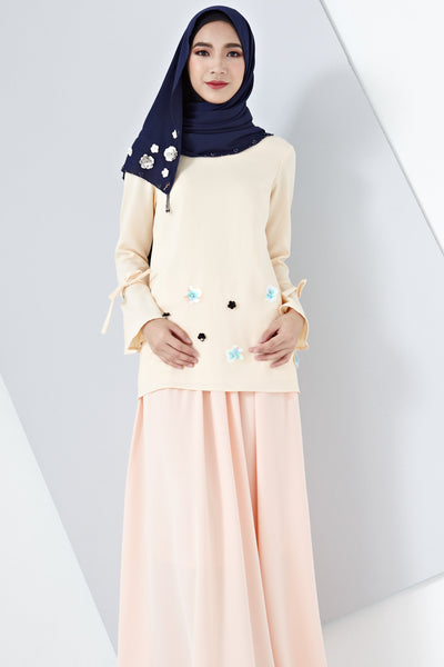 Irma Long Sleeve Top with Floral Embellishment in Pastel Orange
