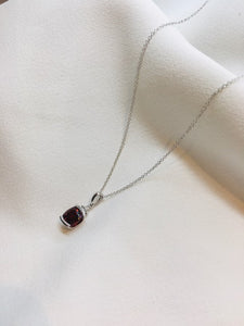 Garnet and white gold pendant
