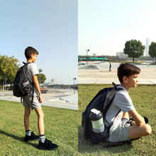 Load image into Gallery viewer, boy wearing black backpack