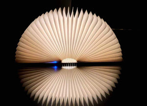 Glowing Book Lamp on Nightstand
