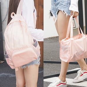 girl with pink backpack and handbag