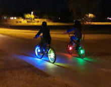 Load image into Gallery viewer, riding bike at night safely with cool wheel lights
