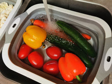 Load image into Gallery viewer, Washing vegetables in plastic tub