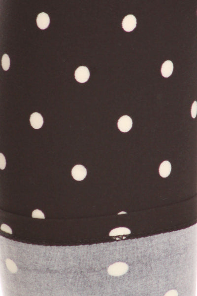 High Waisted Leggings With An Elastic Band In A White Polka Dot Print Over A Black Background