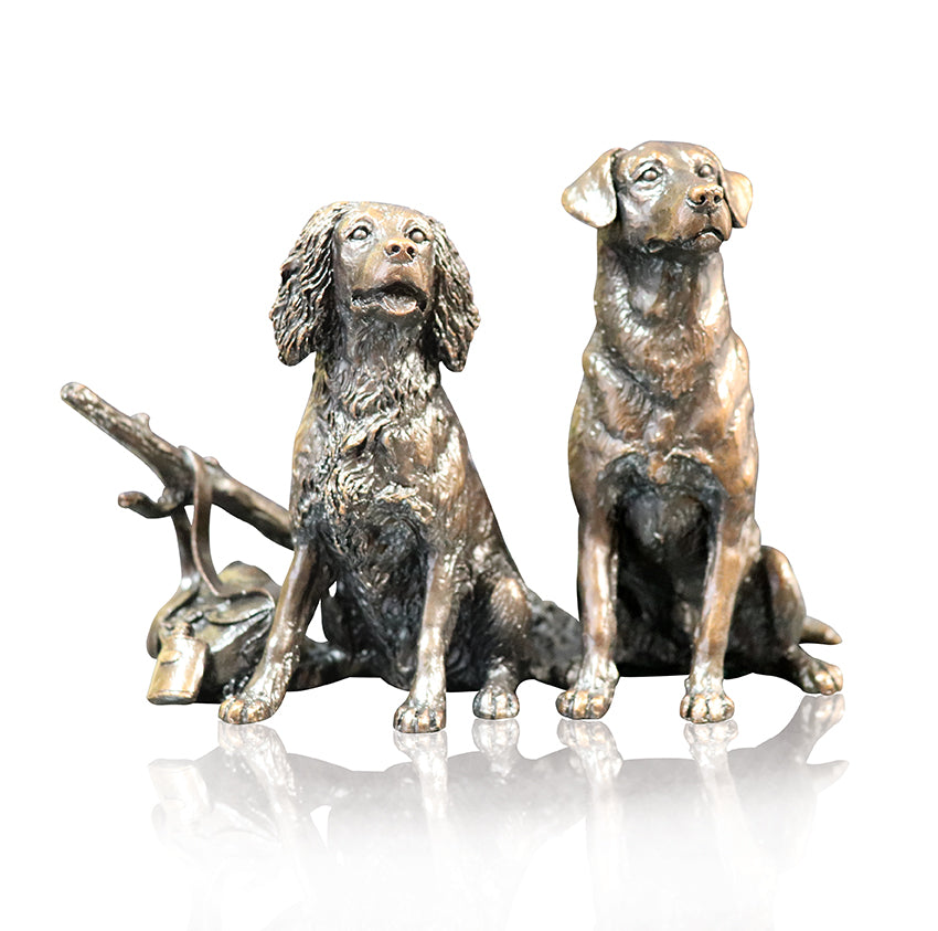 Working labrador springer spaniel sitting waiting bronze sculpture