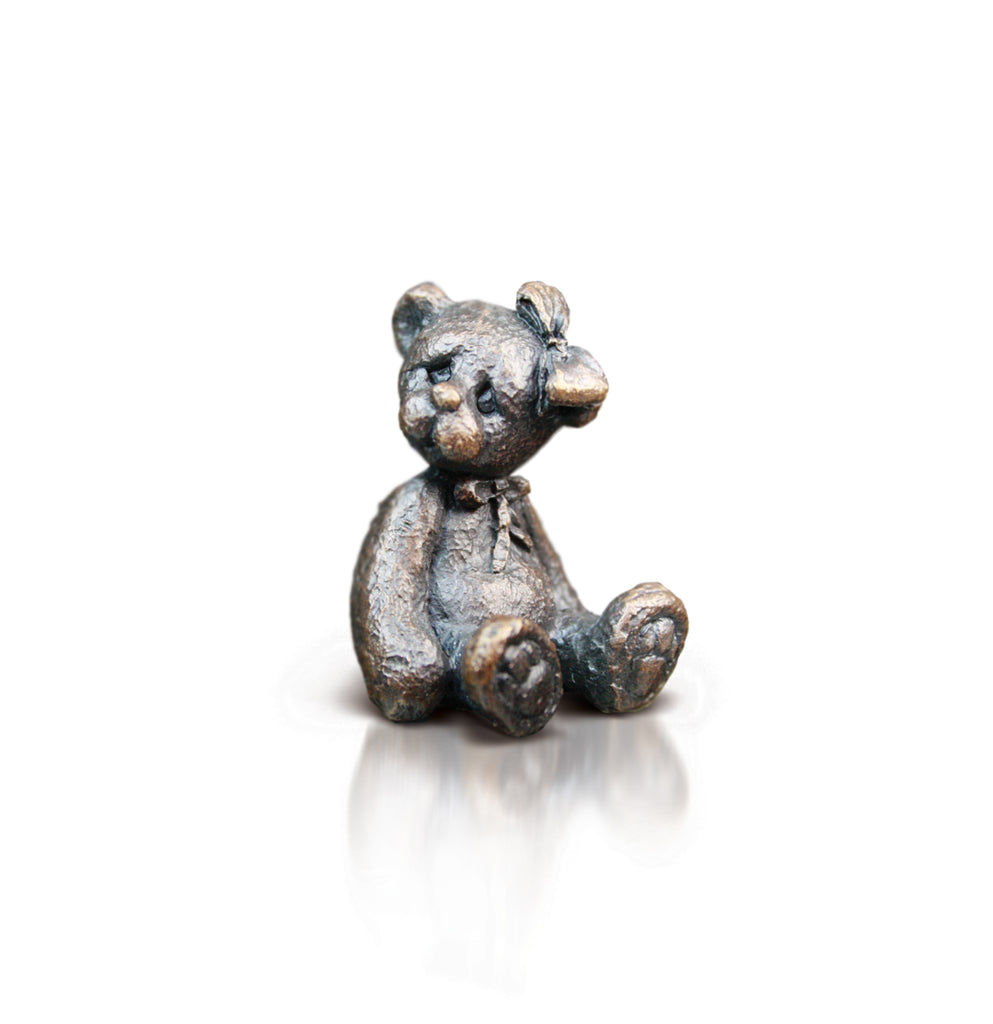bronze bear with bow in hair sculpture