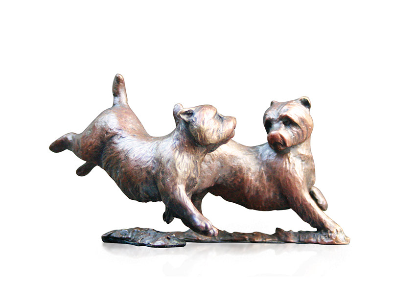 bronze sculpture pair of westies playing together