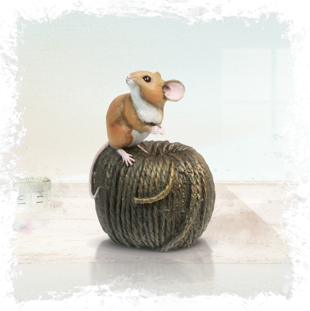 hand painted bronze mouse on twine sculpture