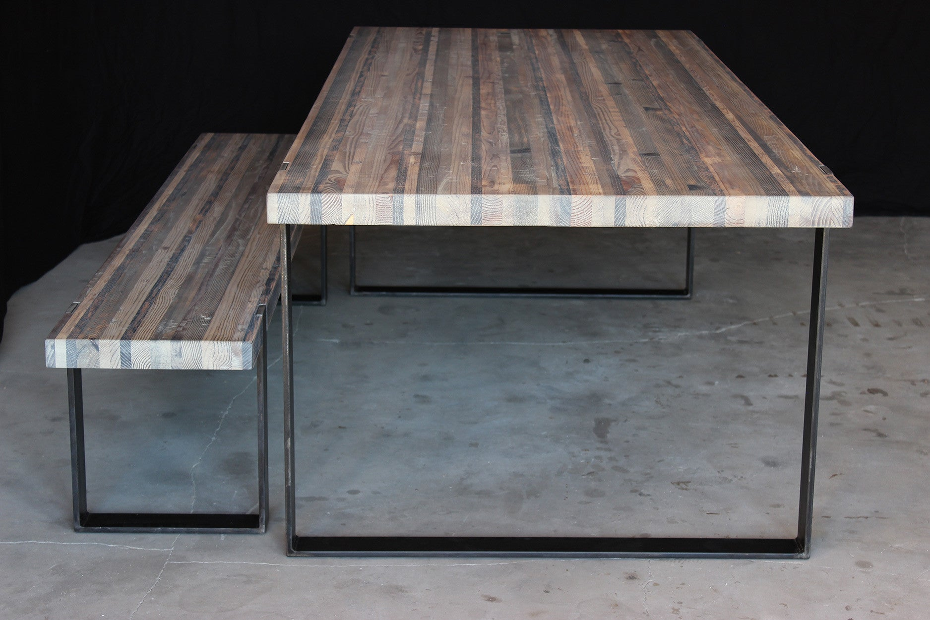 8' original dining table | aged wood finish with waxed steel