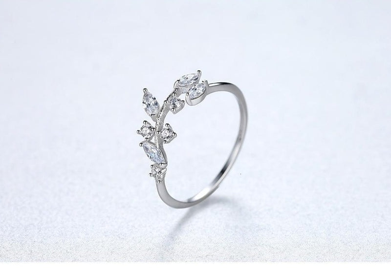 Sterling Silver Handmade Olive Leaf adjustable ring with cubic Zirconia.