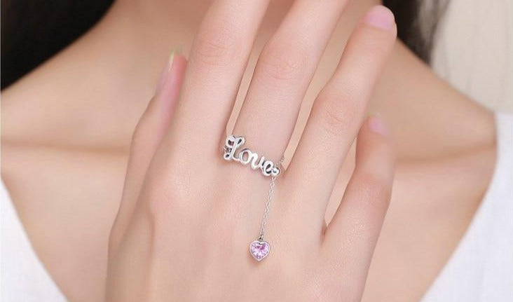 "Sterling Silver ""Love"" adjustable ring with Zircon."