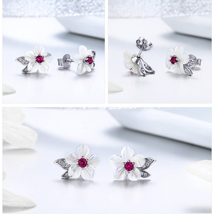 Sterling Silver flower stud earring with Zircon.