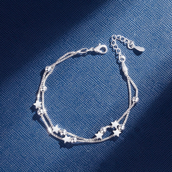 Sterling Silver double chain star shaped bead bracelet.