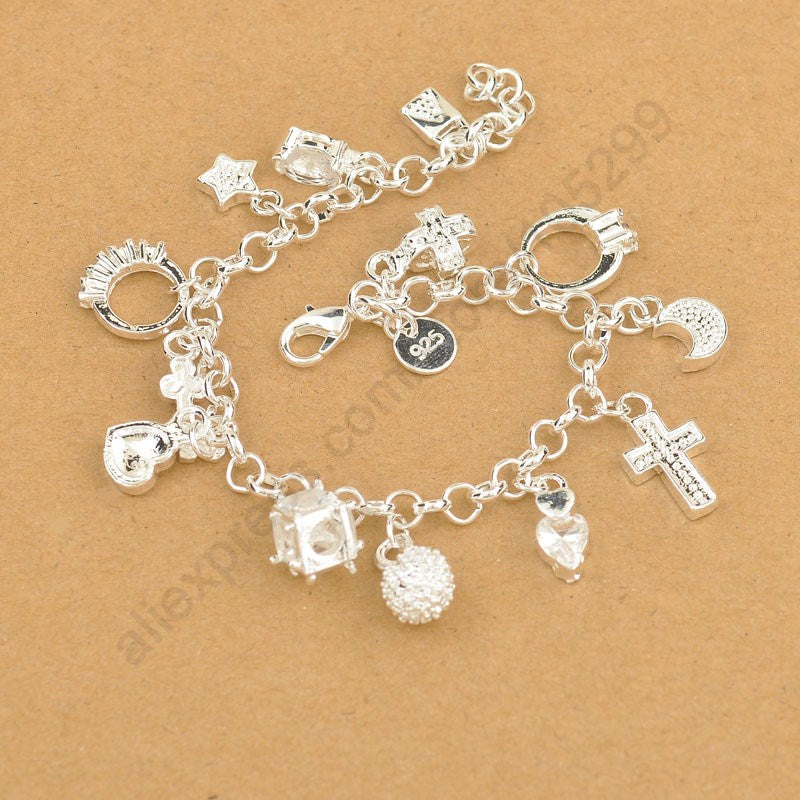 Sterling Silver bracelet with Cross, Moon, Heart  & Clock pendants