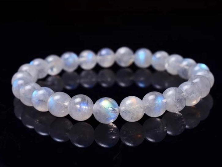 Blue Light Clear Moonstone Crystal Round Beads Bracelet. Sizes- 6mm, 7mm, 8mm, 9mm, 10mm.