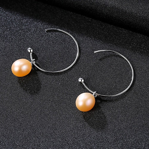 Silver earrings with natural fresh water Pearls