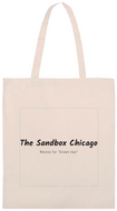 Photo of cotton natural tone tote bag with Sandbox logo in black ink.