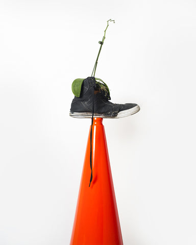 "Jo Karlins, ""What Does a Sneaker with a Dead Orchid on Red Cone Mean?"""