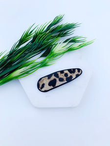 Snap back animal print clips