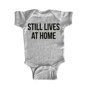 Still Lives at Home Onesie