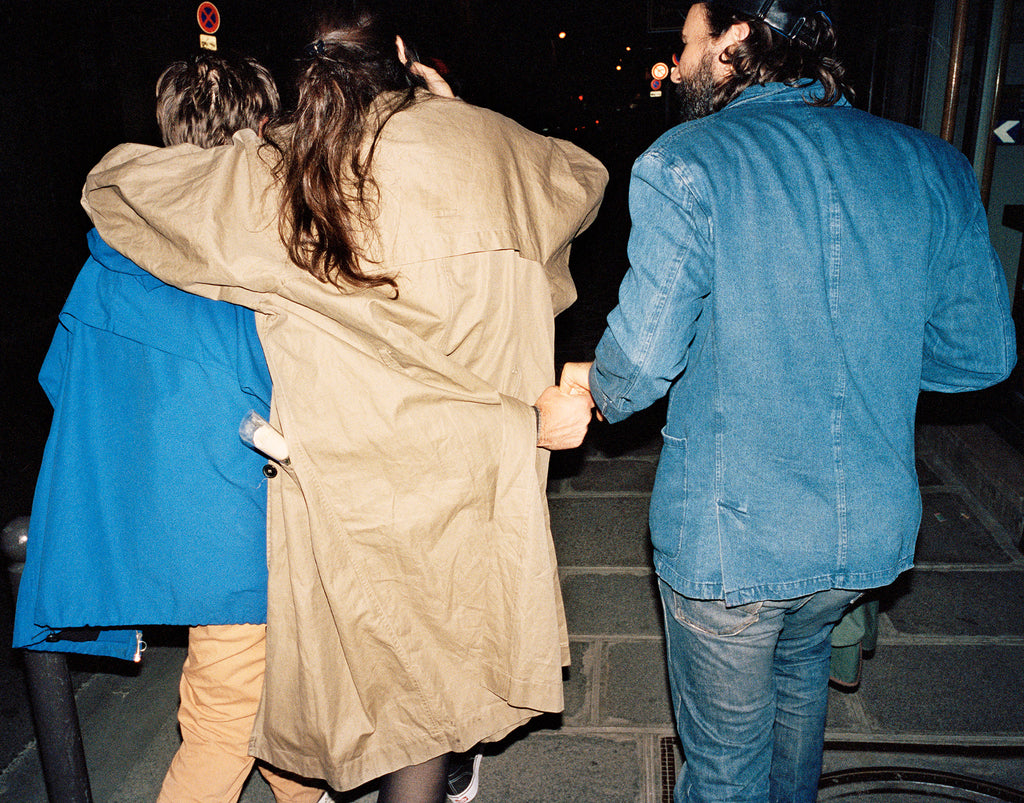 Friends walking together at night in Paris