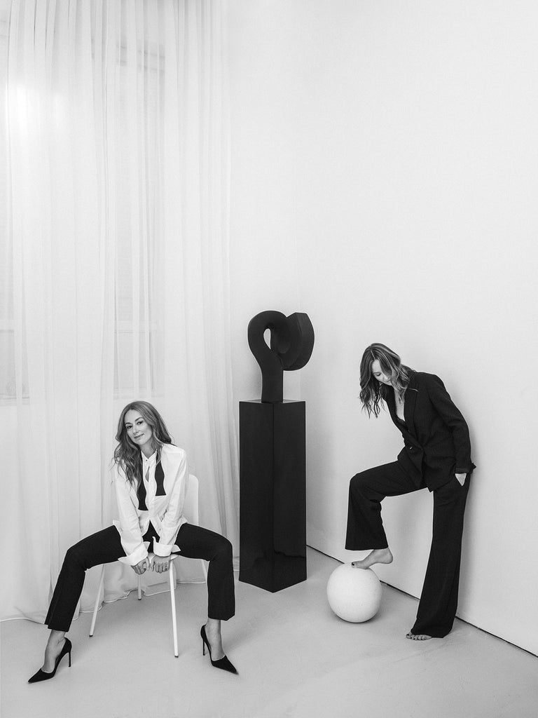 Women sitting on sculptural furniture