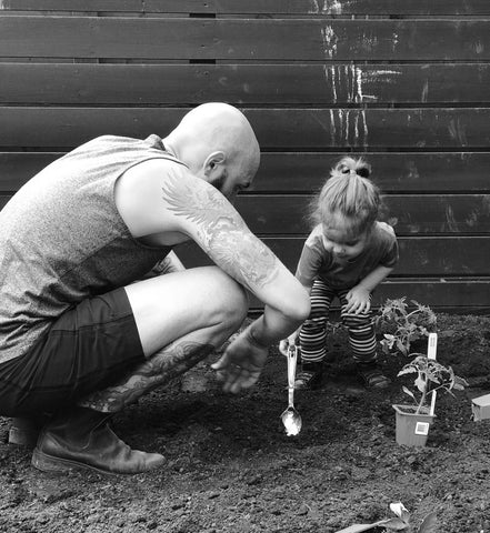 Rob Gentile gardening with his daughter