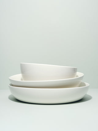 Stack of asymmetrical serving bowls