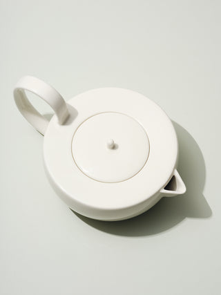 Large white ceramic teapot