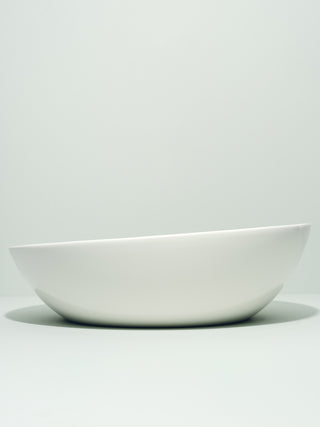 Asymmetrical serving bowl with slanted top