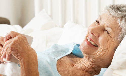 Elderly lady with bed alarm
