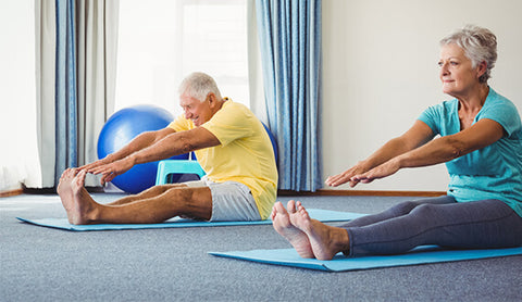 Elderly couple doing yoga