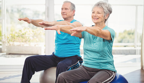 Older couple doing yoga