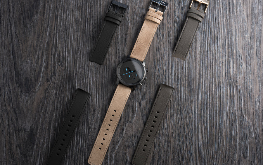 watch on table with multiple straps