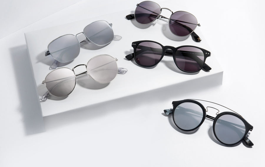 mens sunglasses on display stand