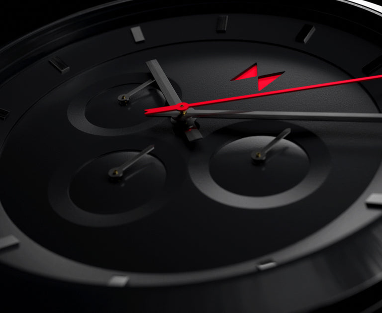 close up of a new black and red watch called the element chrono