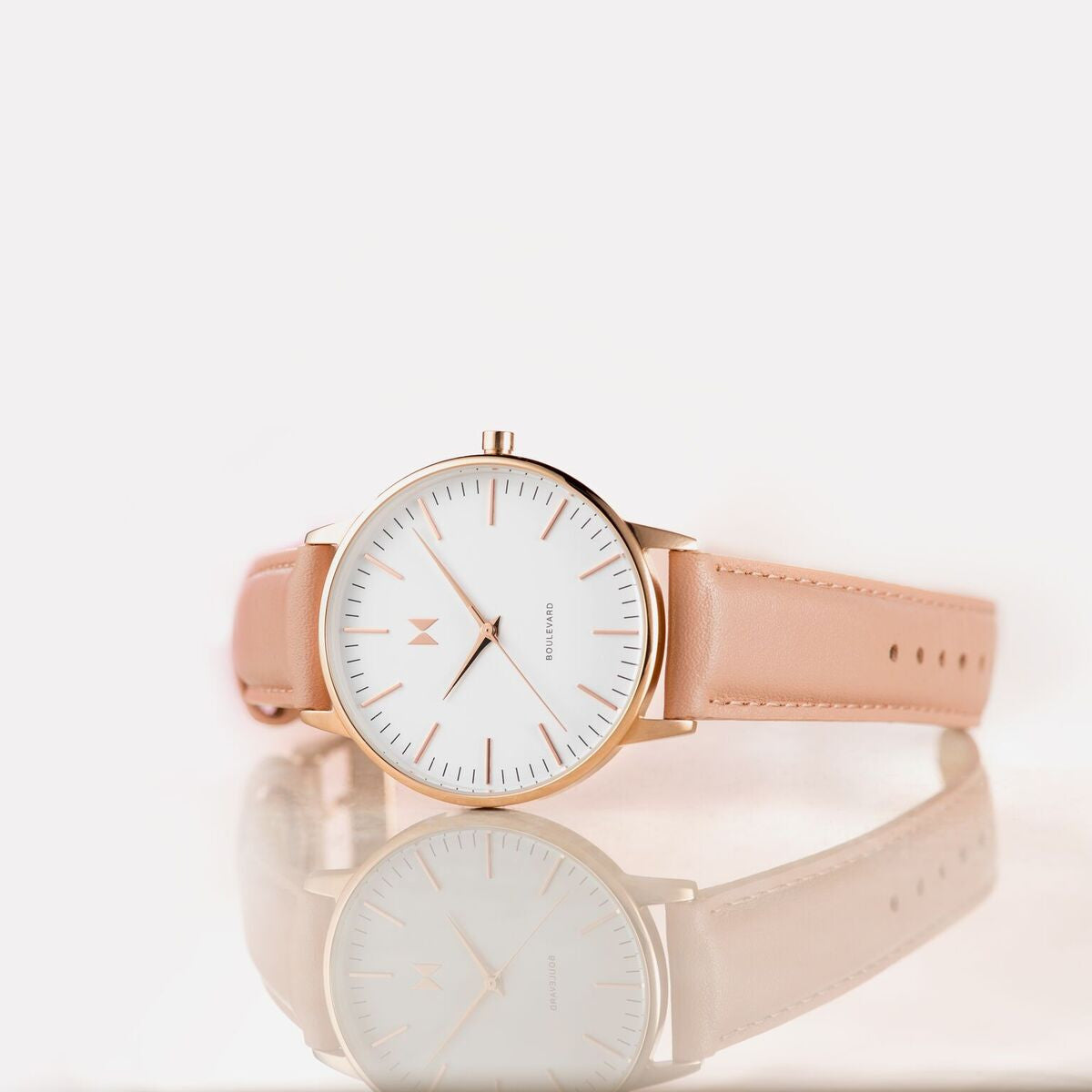 close up of womans gold nude white watch