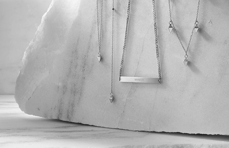 womens jewelry hanging on a marble surface