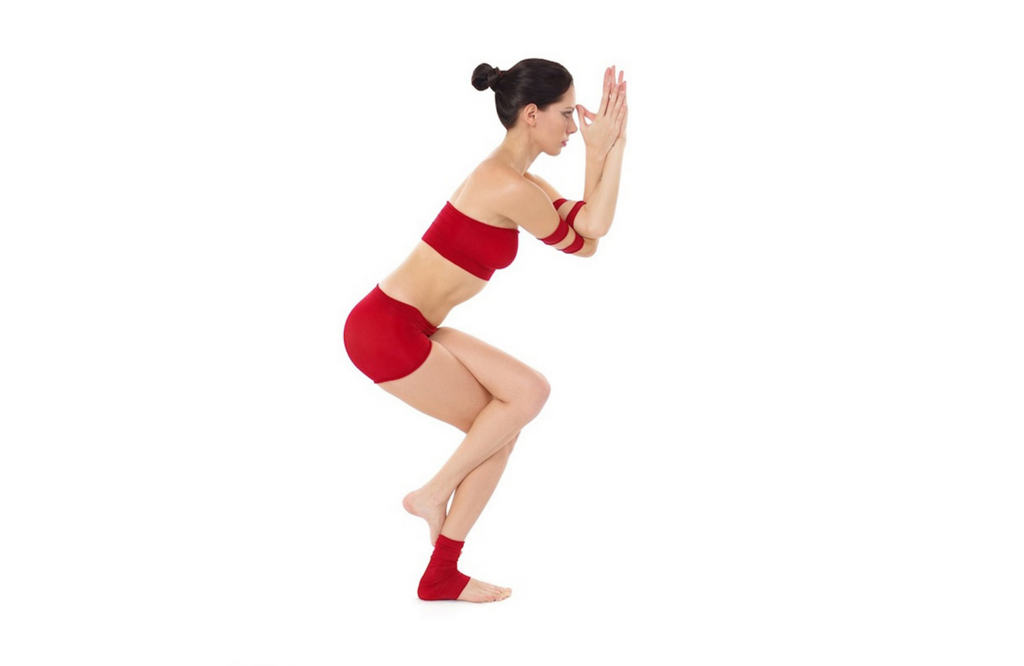 Woman practicing eagle pose