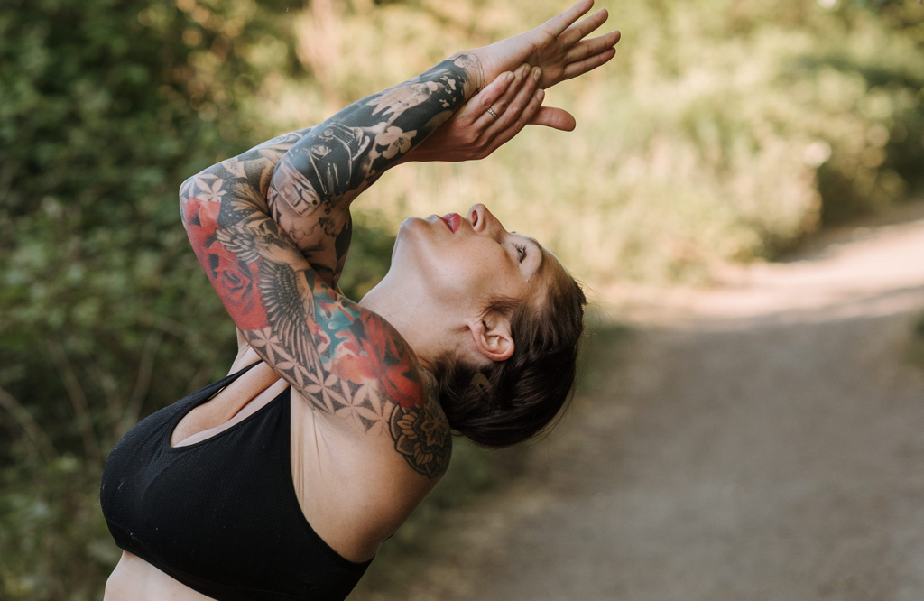 Woman practicing eagle pose outdoors