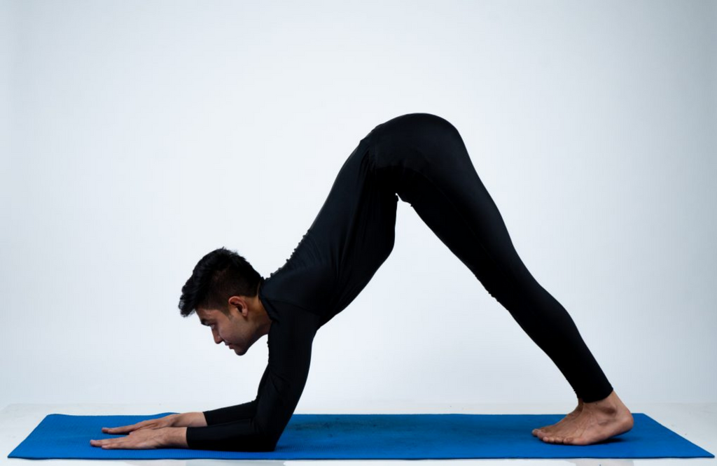 Man practicing dolphin pose