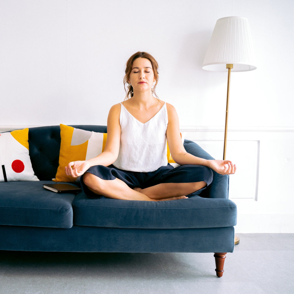 woman practicing chair yoga
