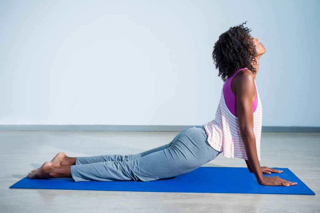 young woman in cobra pose