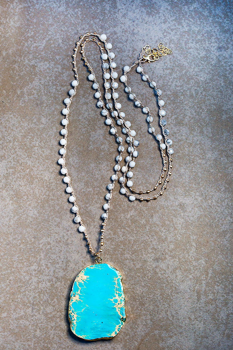 turquoise slice on white beaded necklace