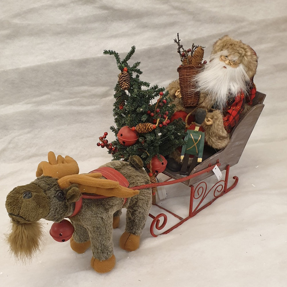 Santa in sleigh with reindeer