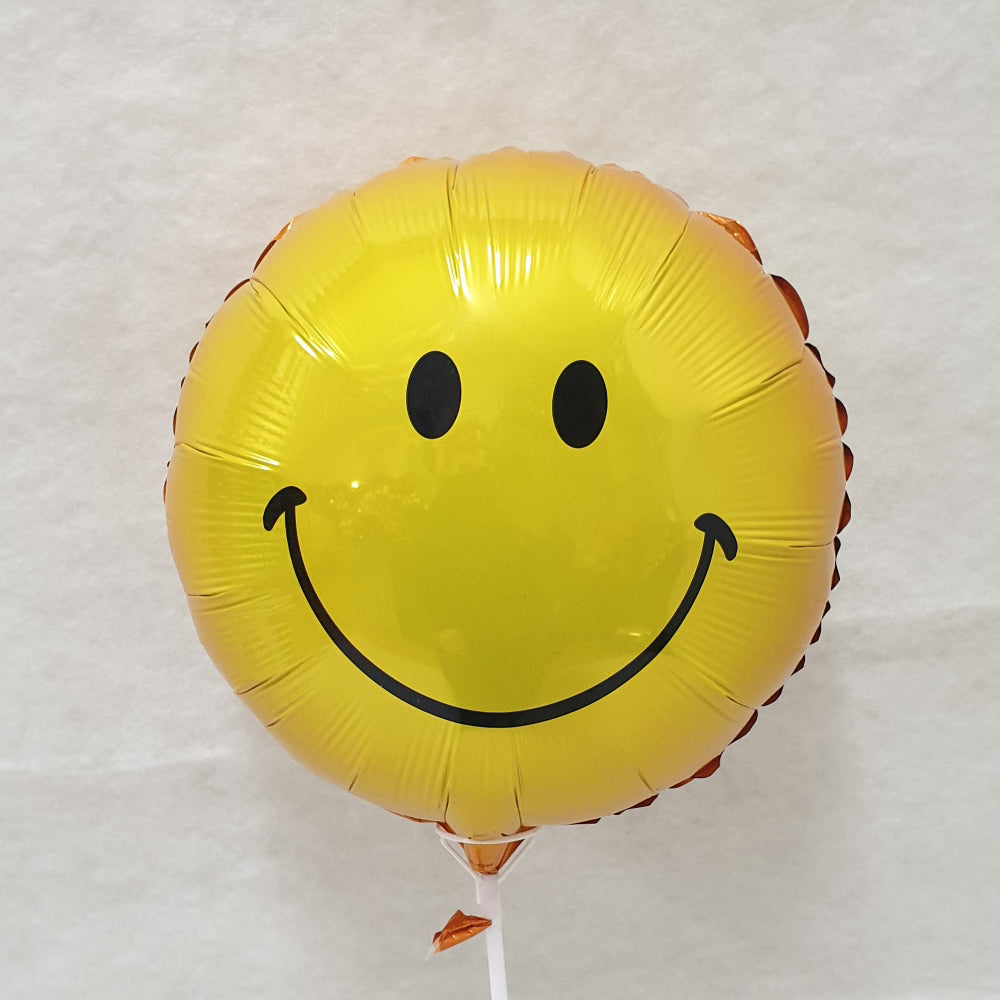 Yellow smiley face balloon - uninflated